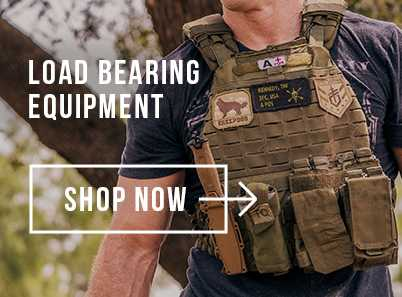 Man walking through the woods wearing a a blue top and a 5.11 TacTec Plate Carrier