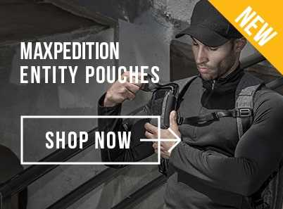 Man wearing black long sleeved top and black baseball cap closing a Maxpedition Entity Utility Pouch