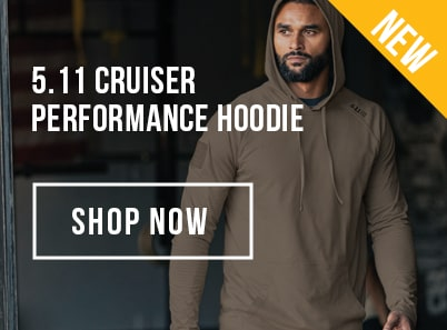 Man wearing a ranger green 5.11 tactical cruiser performance long sleeve hoodie