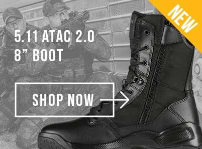 Two military soilders crouching down and holding a gun wearing black 5.11 Atac 2.0 8 inch boots